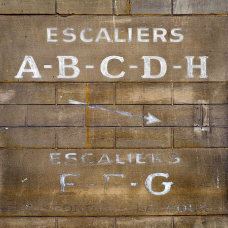 french text: Vintage wall background, french text Stock Photo