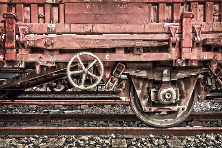 railway transportation: Rusty old freight wagon on a railway line Stock Photo