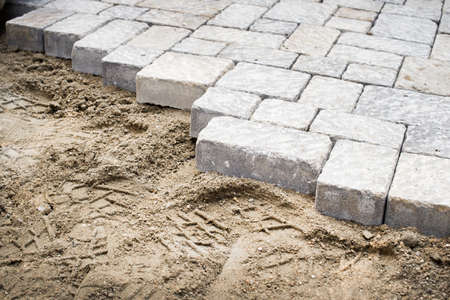 pavement: Pavement laying in a yard Stock Photo
