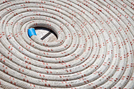 coiled rope: Close up of a rope coiled on a sailboat Stock Photo