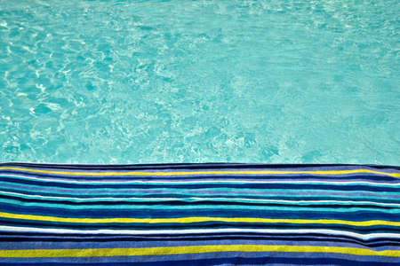 turquoise water: Swimming pool and bath towel