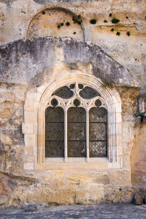 monolithic: Outside view of a window of Saint Emilion monolithic church