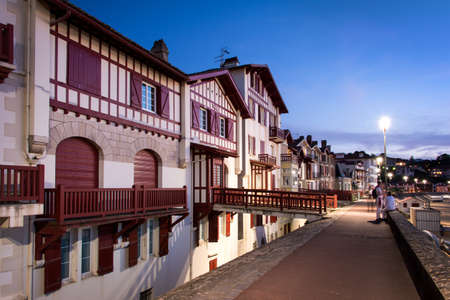 pays: Traditional labourdine houses of Saint de Luz at night, Basque Country, France