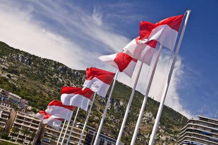 monegasque: Monegasque flags on the harbor of the Monaco principality, french riviera