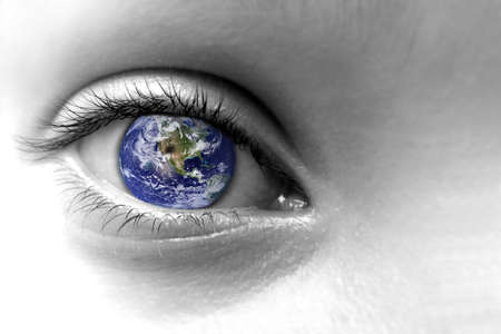 Close up of an eye with the earth in its iris, elements of this image are furnished by NASA Banco de Imagens