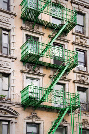 newyork: Green outside metal fire escape stairs, New York City, USA