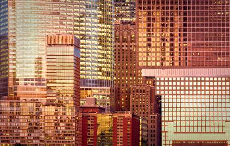 modern background: Modern glass building background at sunset, New York City, USA