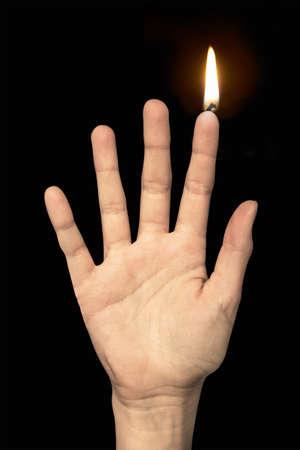 flame like: Flame on a finger like a candle Stock Photo