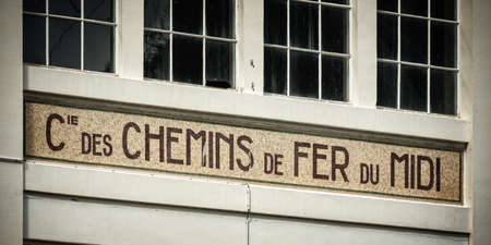old building facade: Old building facade of a famous ancient railway company called chemins de fer du midi Editorial
