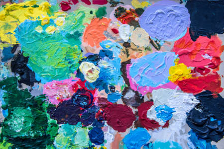 paint palette: Background image of bright paint palette closeup