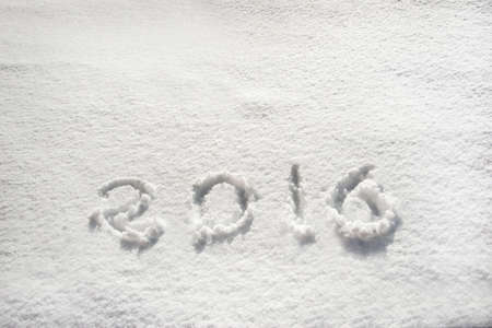 snowbanks: 2016 written in snow, holiday background