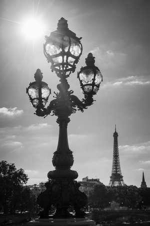 alexandre: Street lantern on the Alexandre III Bridge against the Eiffel Tower in Paris, France