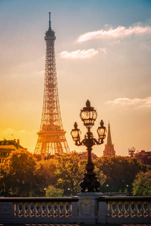 Street lantern on the Alexandre III Bridge against the Eiffel Tower in Paris, France
