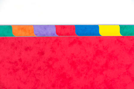 categorized: Photo of colorful folder dividers with copy space, white background Stock Photo