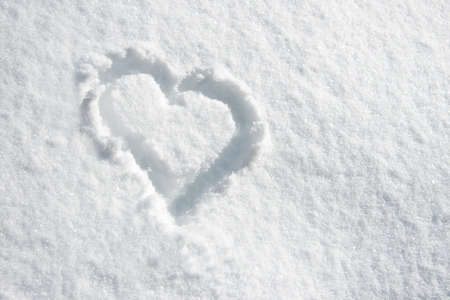 winter holiday: Close up of a heart n the snow Stock Photo