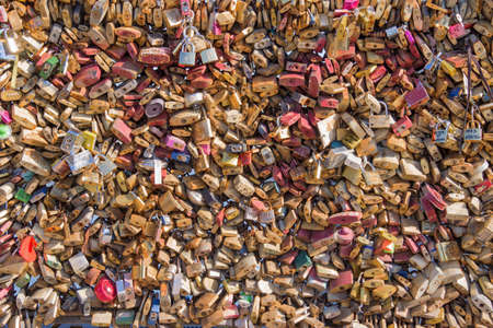 heavy heart: Background of many love lockers on a bridge in Paris, France Editorial