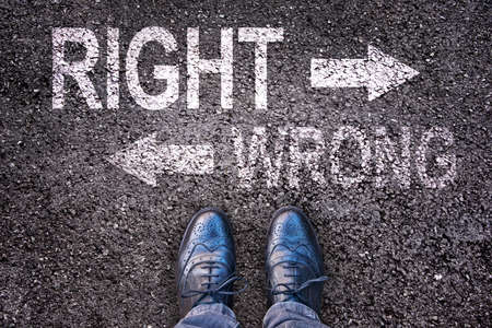 new solution: Feet and words right and wrong painted on an asphalt road Stock Photo