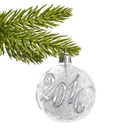 pine tree: 2016 on a silver christmas ball hanging from a branch isolated on white