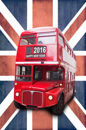 transport icon: Happy new year 2016 written on a London vintage red bus, Union Jack background Stock Photo