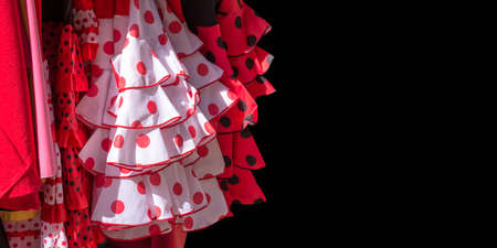 traditional pattern: Red flamenco dresses on black background in Seville, Andalusia, Spain