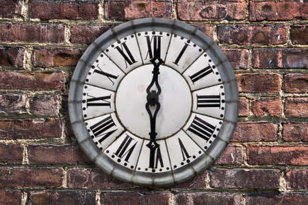 6 12: Vintage retro style clock on a red brick wall