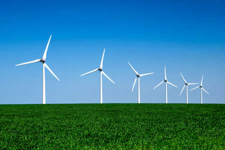 global innovation: Graphic modern landscape of wind turbines aligned in a green and yellow field