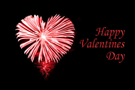 love blast: Happy valentines day, red fireworks in the shape of a heart