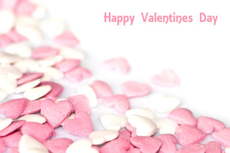 hearts background: Valentines card, pink sugar hearts on white background