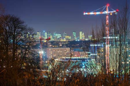 la defense: Construction site at night in Paris, La defense in the background Stock Photo