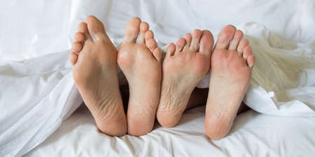 in: Feet of a couple in a bed