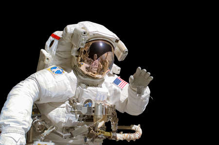 Close up of an astronaut isolated on black background