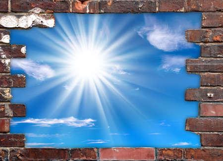 clay brick: Brick wall frame and blue sky with sunshine Stock Photo