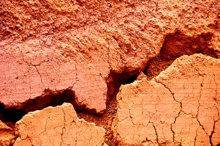 red clay: Red earth background with a big crack