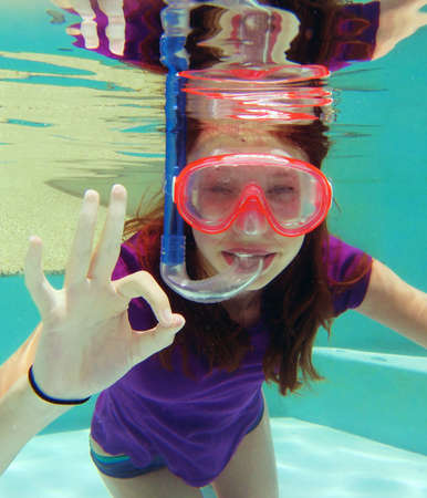 water sports: Girl with mask and tuba underwater