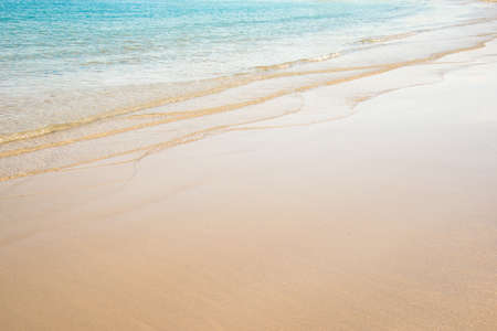 white sand beach: Close up on the edge of a beach with turquoise water