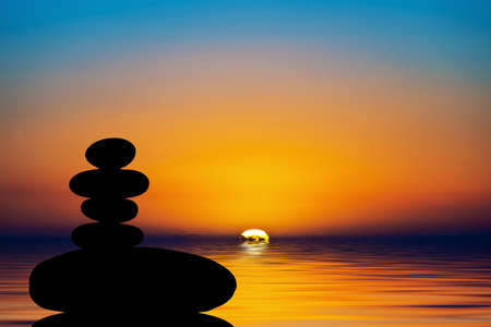 Silhouette of a stack of stones in the sunset Banque d'images