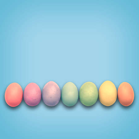 aligned: Pastel Easter eggs aligned, blue background Stock Photo