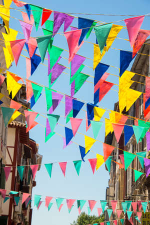 street party: Colorful garlands decorating the streets of the city of Bayonne during the summer festival (fetes de Bayonne) in august Stock Photo
