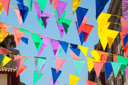 pays: Colorful garlands decorating the streets of the city of Bayonne during the summer festival (fetes de Bayonne) in august Stock Photo