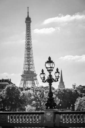 iii: Street lantern on the Alexandre III Bridge against the Eiffel Tower in Paris, France