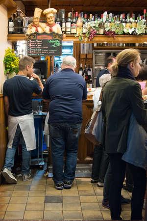 4 people: SAN SEBASTIAN, SPAIN - AUGUST 4: People in a typical tapas bar on August 4, 2015  in San Sebastian