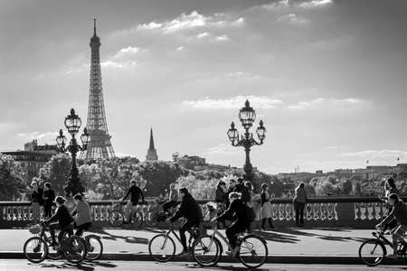alexandre: PARIS, FRANCE - SEPTEMBER 27: People on bicycles and pedestrians enjoying a car free day on Alexandre III bridge on September 27, 2015 in Paris Editorial