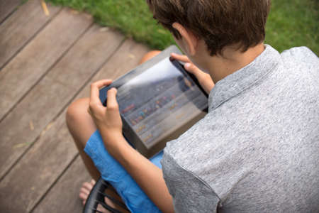 tablet computer: Boy with a tablet outdoor