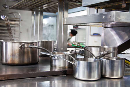 Pans in a professional kitchen Stock Photo