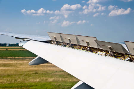 aircraft: Close up on plane wing spoiler at landing