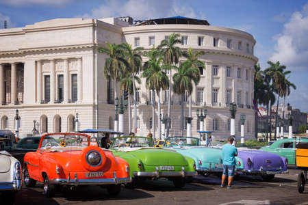 capitolio: HAVANA, CUBA - APRIL 18: Vintage american cars parked in front of the Capitolio in Old Havana, on April 18, 2016 in Havana