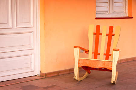 rocking chair: Rocking chair in a patio of a house in Vinales, Cuba