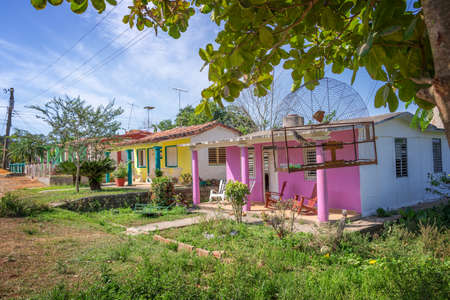 Bird cage and colorful houses in Vinales, Cuba