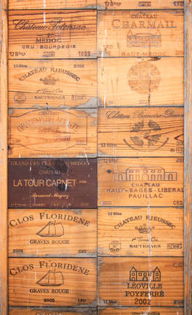 Collection of old Bordeaux wine wood boxes Editorial