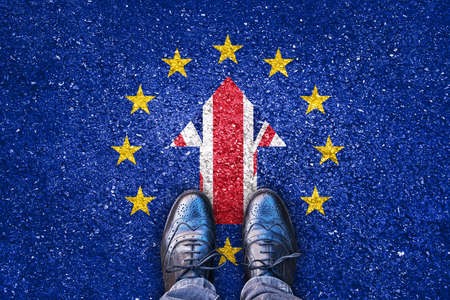 no way out: Brexit, flags of the United Kingdom and the European Union on asphalt road with legs